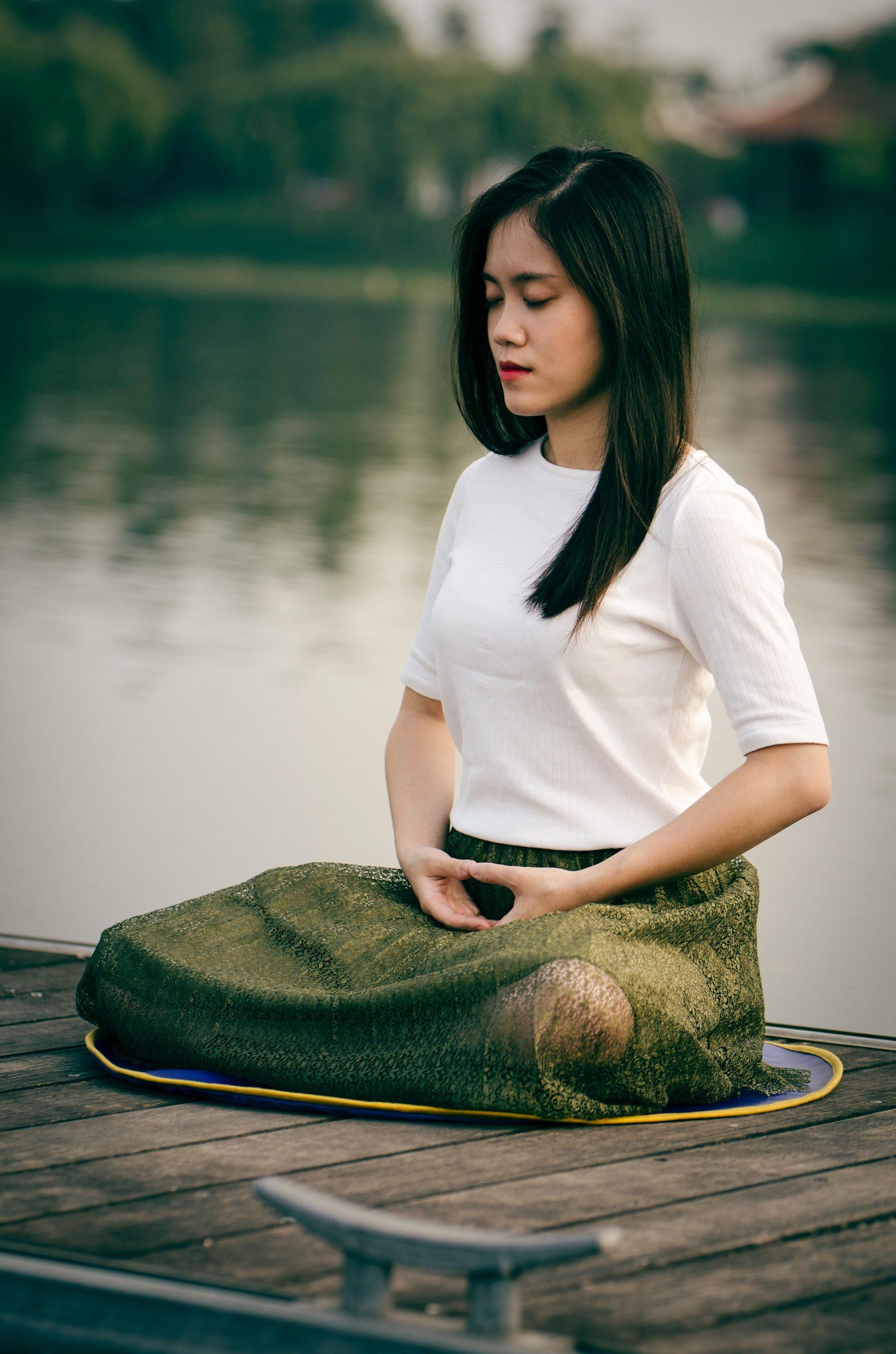 woman-meditation-water